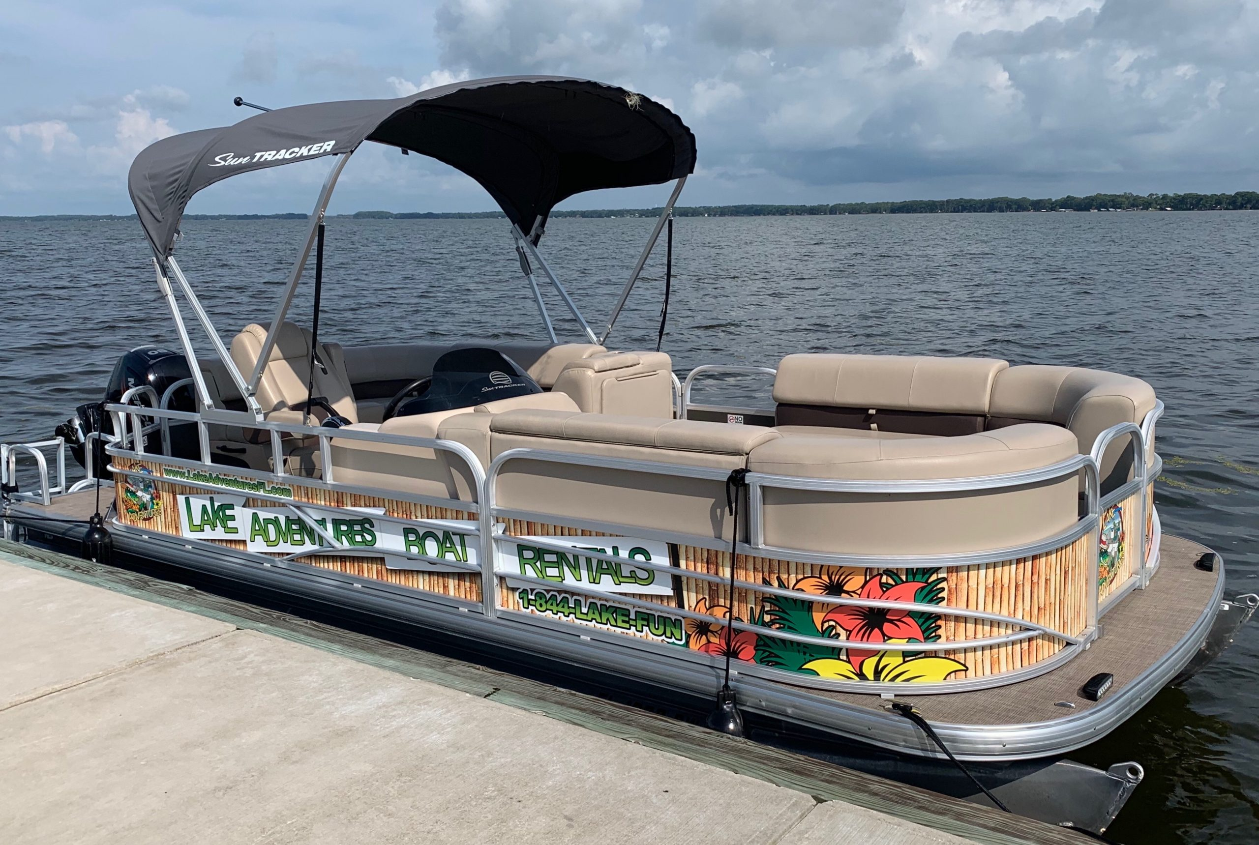 image of 20' pontoon boat with lounge seating and black canopy